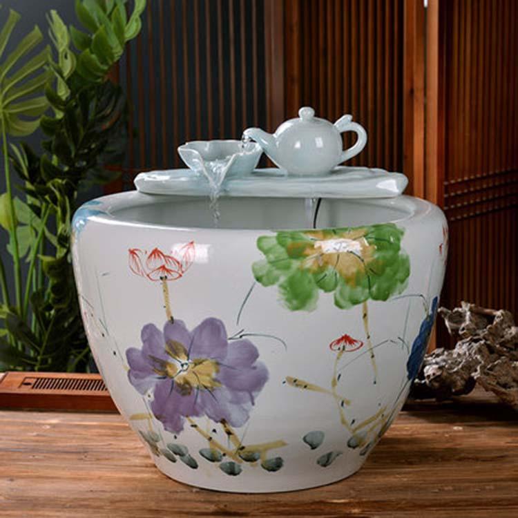 景德镇黄底浮雕龙纹瓷器缸
